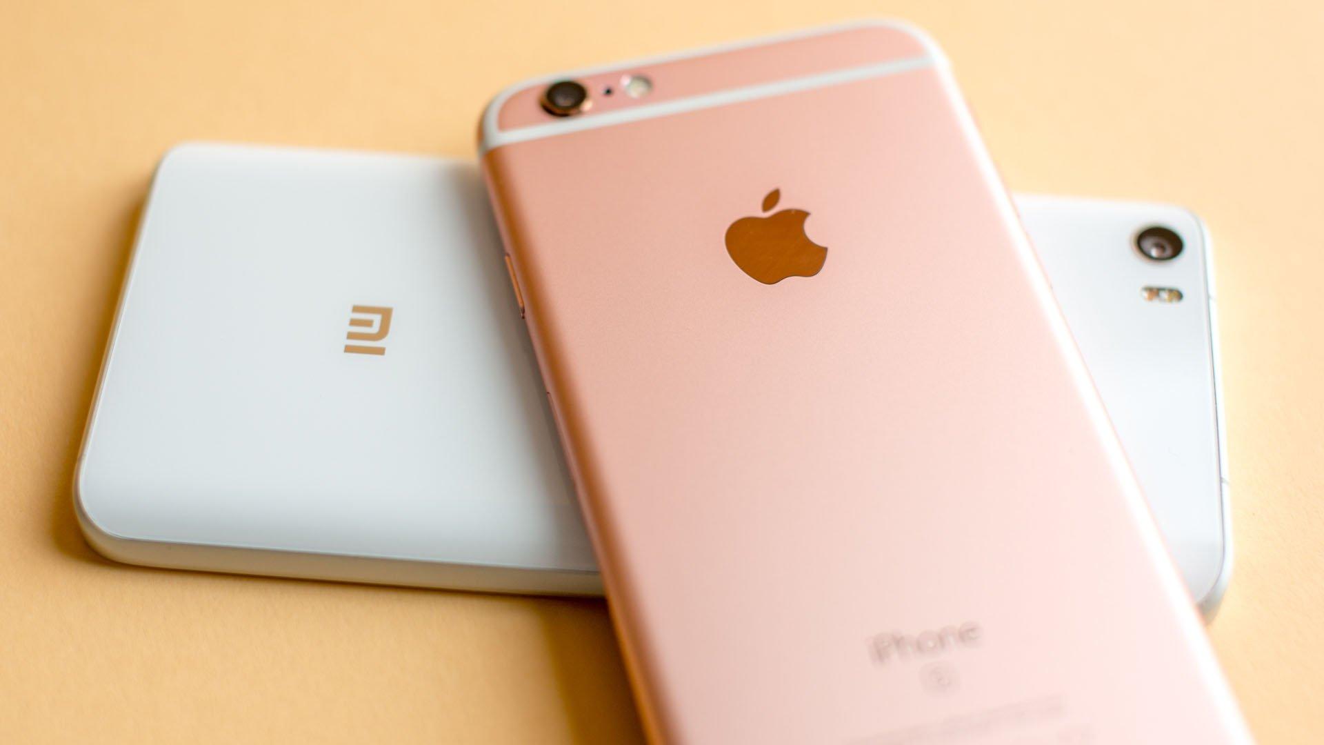 androidpit-xiaomi-mi5-vs-apple-iphone-6s-logo