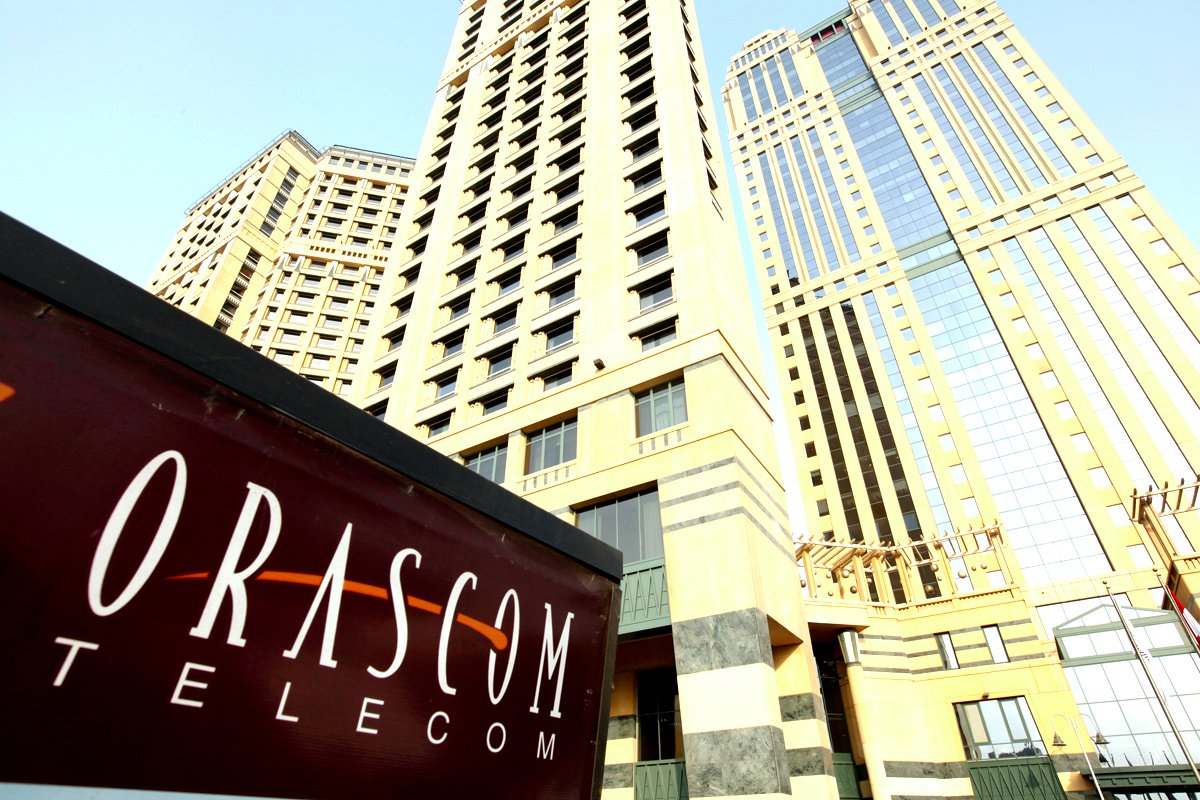 An Orascom Telecom Holding SAE sign sits outside the company's headquarters at Nile City Towers, in Cairo, Egypt, on Tuesday, Oct. 5, 2010. OAO VimpelCom's borrowing costs are falling to record lows, a sign investors will support higher indebtedness to fund acquisitions as the Russian mobile-phone operator buys assets from Egyptian billionaire Naguib Sawiris. Photographer: Shawn Baldwin/Bloomberg